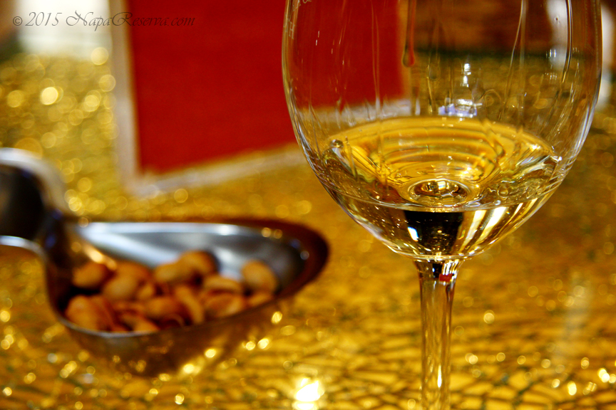 Golden white wine glass with pistachio nuts S