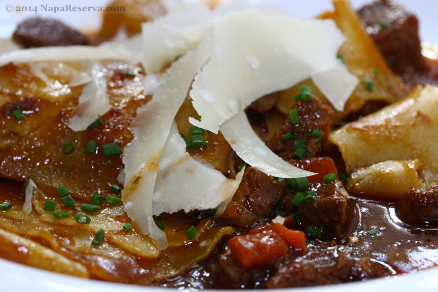 beef stew with shaved parmesan